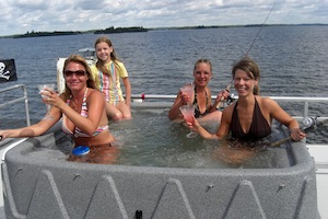people in lake hot tub